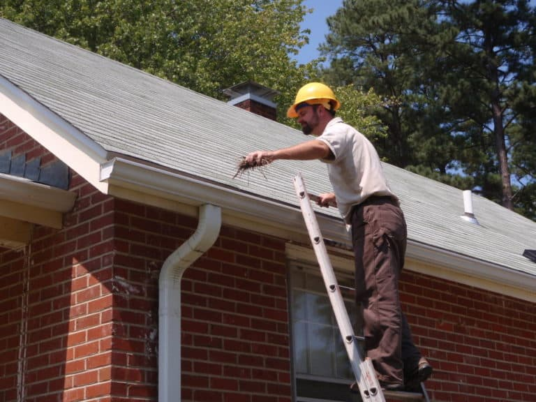 Residential Roofing Services New Brighton MN - Man Working On Gutters