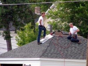 Residential Roofing Services Shoreview MN - Two Men Talking on a Roof