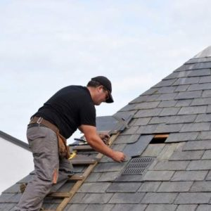 Residential Roofing Services Andover MN - Roof Repairman Working on Shingles
