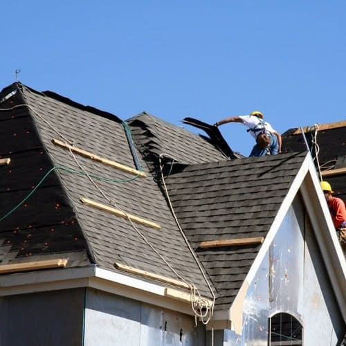 Residential Roofing Services - Men Working on a Roof