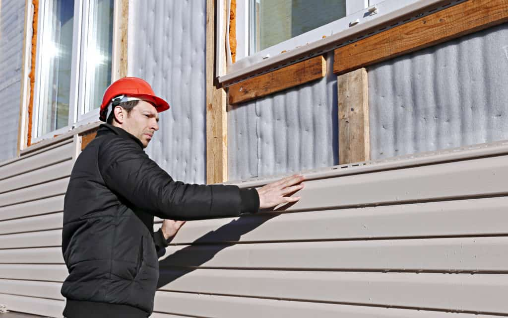 Siding Repair Minneapolis -Man Working on Replacing Siding