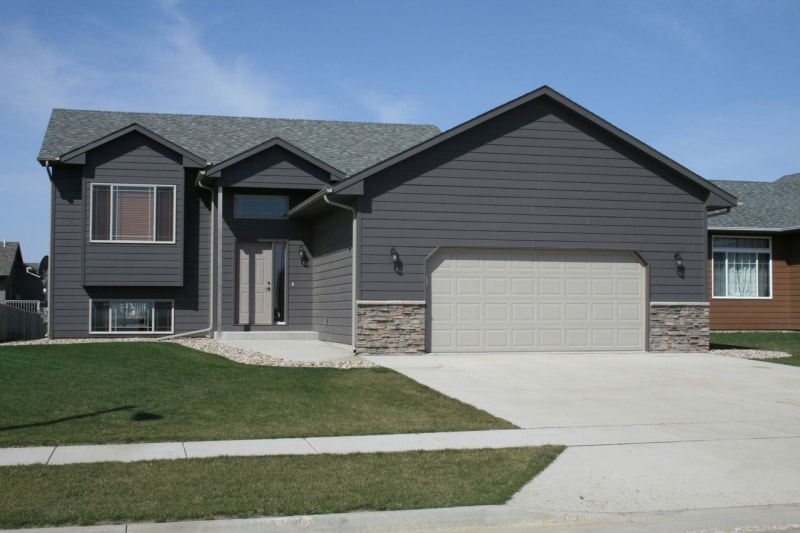 Roofing and Siding Contractor St Anthony Minnesota - A House with New Blue-Grey Vinyl Siding