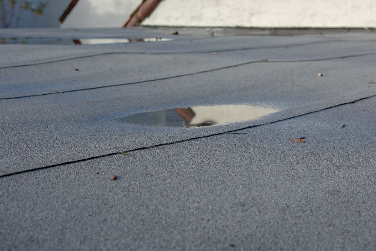 How To Deal With Flat Roof Repairs Sellers Roofing