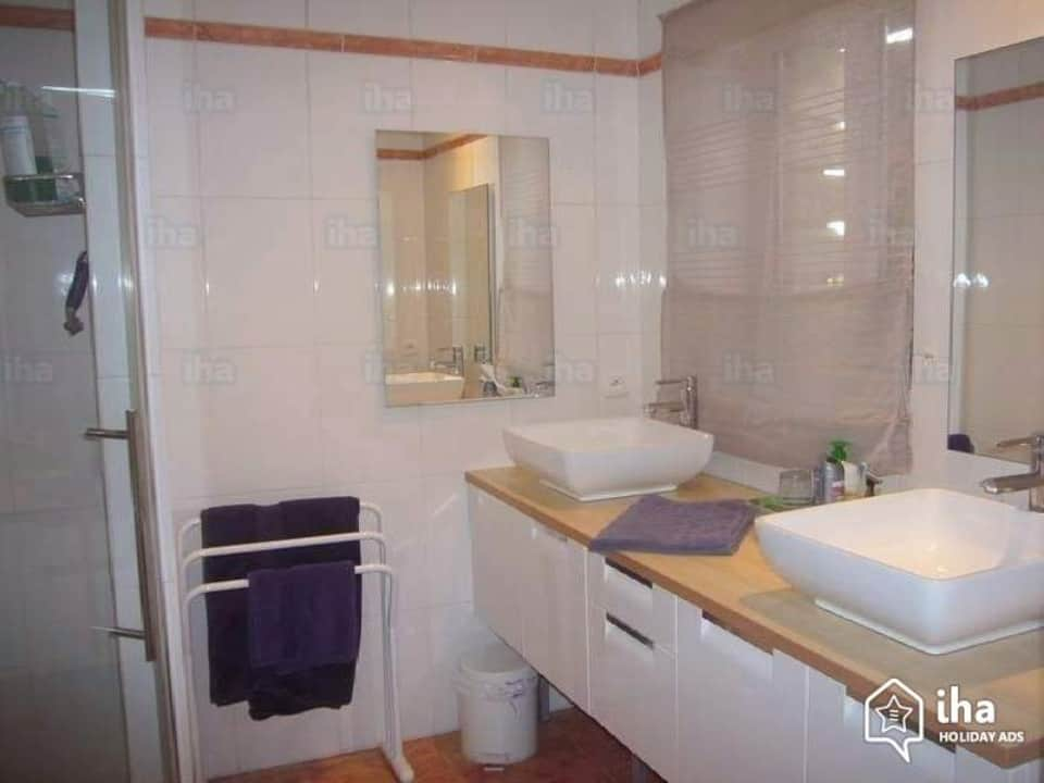 Worst Home Improvements for ROI - A White and Black Accented Mid-Range Bathroom Picture