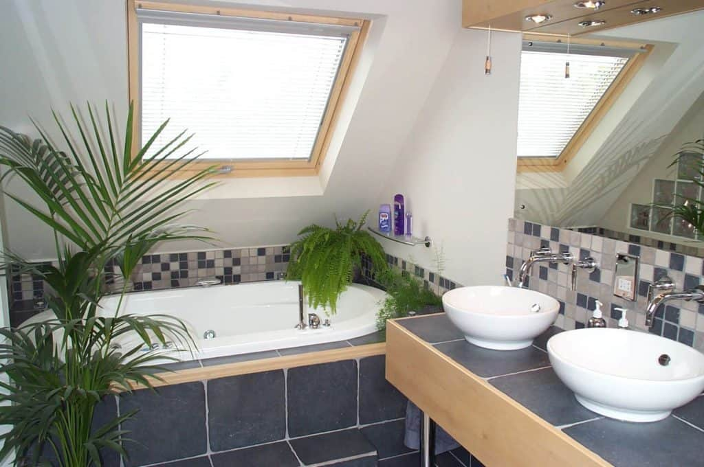 Home Improvement Return on Investment Guide 2020 - A Remodeled Attic Bathroom with Marble Countertops and New Tub and Sinks