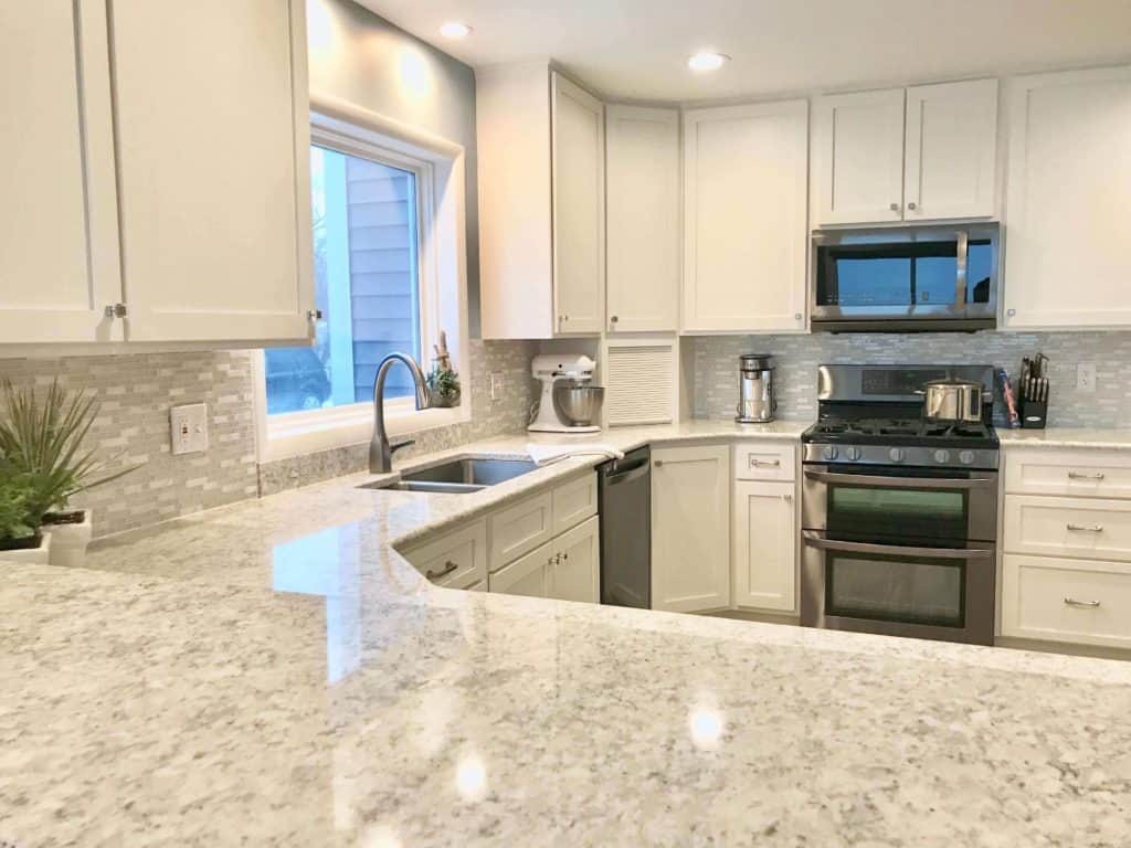 Home Improvement Return on Investment Guide 2020 - A Remodeled Kitchen with Porcelain Countertops and Stainless Steel Appliances