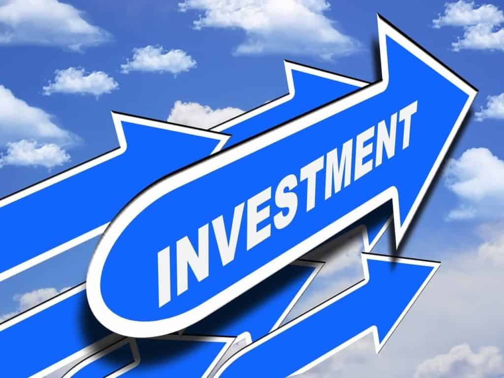 Home Improvement Return on Investment Guide 2020 - Blue Signs On a Sunny Day Background that are Pointing Up with the Word Investment Written on Them