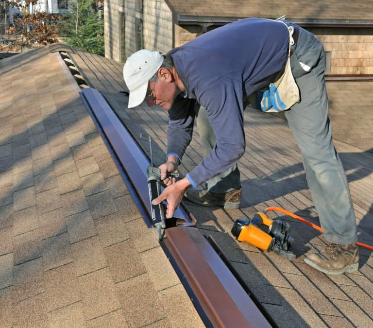 What is the Best Roof Vent for a House - A Roofer Installing Ridge Vent on the Roof of a House