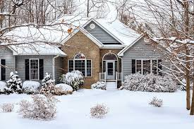 Siding Repair Minneapolis & St Paul - A Snow Covered Home with Brick and Vinyl Siding