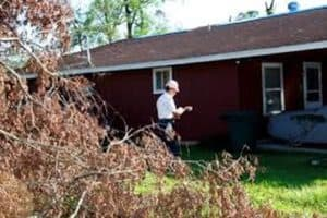 Dealing with Insurance Adjuster on Hail Damage Claims - A Man Inspecting a House