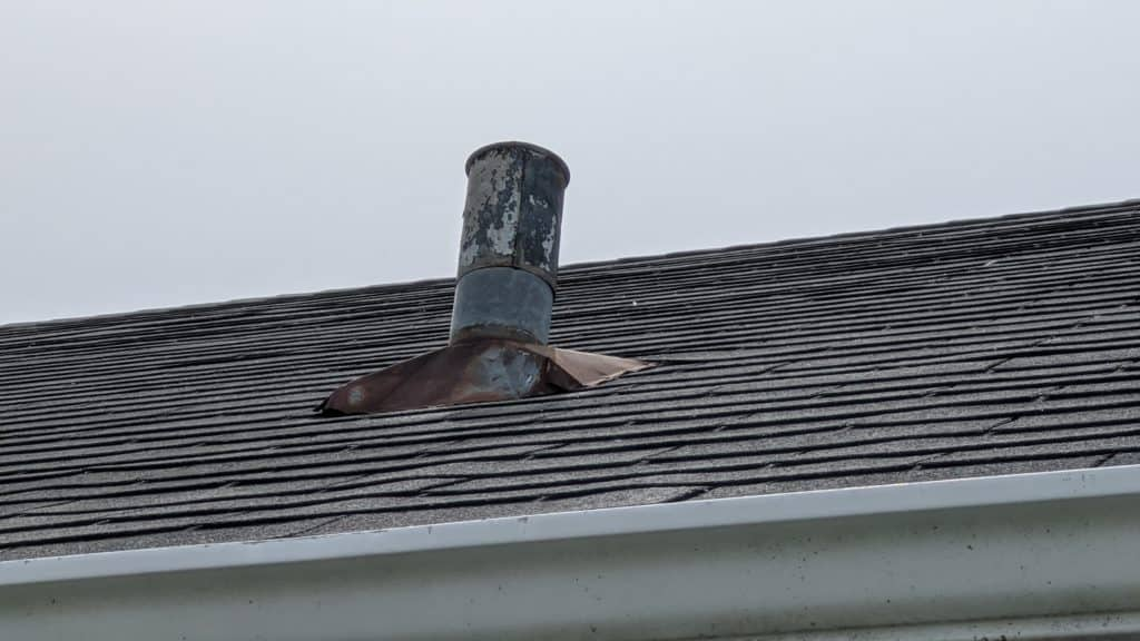 What does wind damage look like on a roof in New Brighton, MN