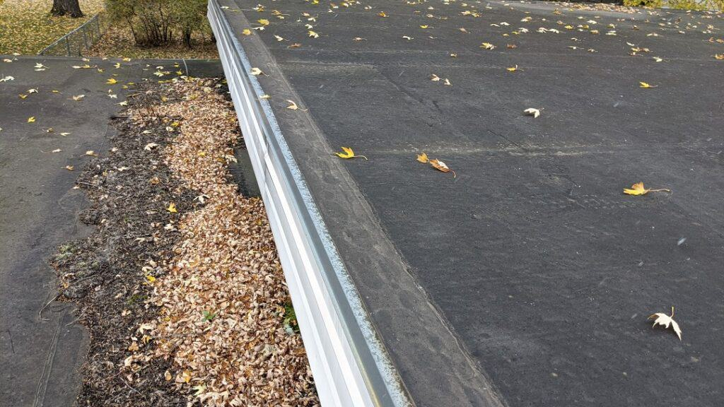 What does hail damage look like on a flat roof