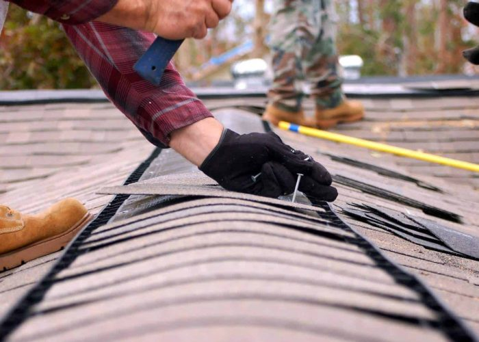 Residential Roofing Services Shoreview MN - Man Working On Roof